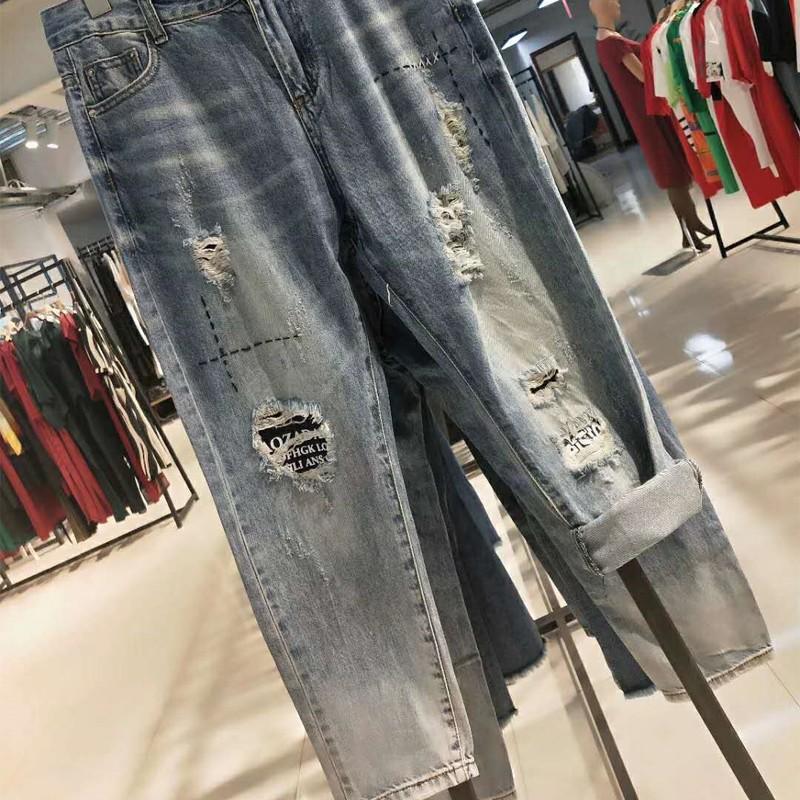 19夏季潮流阔腿韩版牛仔裤破洞简约折扣女装尾货哪里拿货